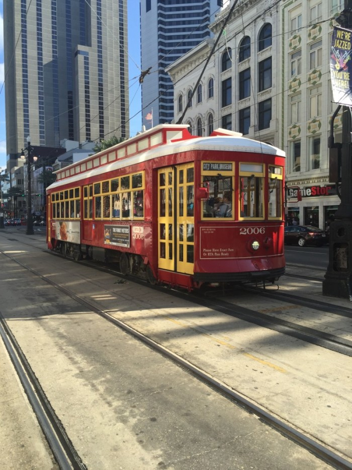 picture of a red and yellow trolley car