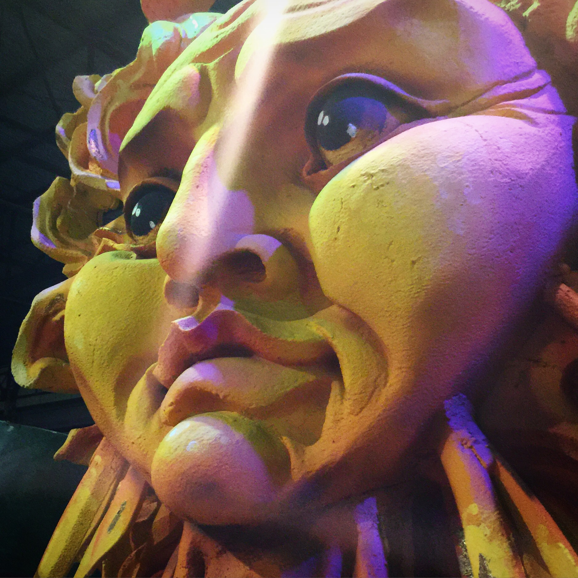 sun face sculpture at Mardis Gras World